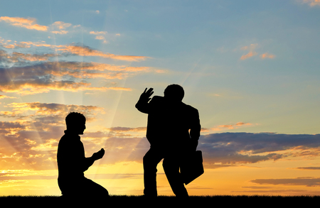 Social inequality. Silhouette of the rich and the poor man at sunset Stock Photo