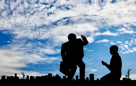 inequality: Social inequality. Silhouette of the rich and the poor man on the background cityscape