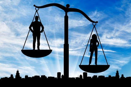 dominance: Feminism concept. The dominance of women against men, on the scales of justice Stock Photo
