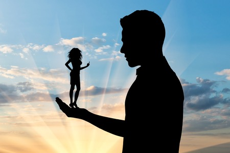 Feminism concept. Silhouette of a small woman showing hand gesture, fuck you, in the hand of a large man