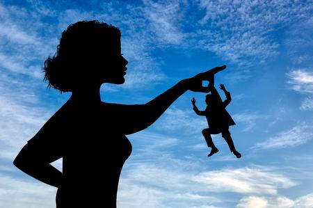feminist: Silhouette feminist holding a small man. Concept of feminism.