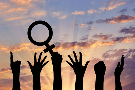 Silhouette of hand movements feminists holding the symbol of Venus mirror. feminist concept Imagens