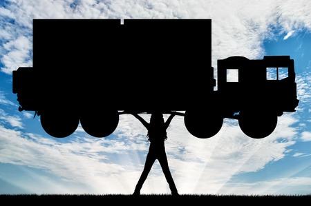 dominance: Silhouette of strong feminist, lifting trucks. Concept of feminism.