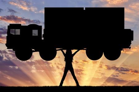 feminist: Silhouette of strong feminist, lifting trucks. Concept of feminism.