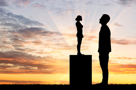 dominance: Feminism concept. Silhouette of a small woman standing on a level more men
