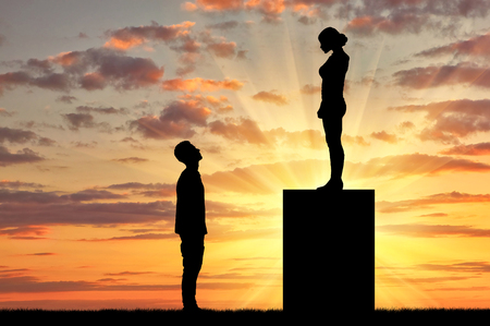 feminism: Feminists silhouettes standing on a pedestal looking down at the man. Feminism concept Stock Photo