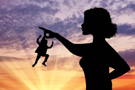 female domination: Silhouette feminist holding a small man. Concept of feminism.