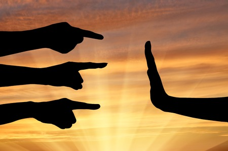 slander: Defending their rights concept. Silhouette of hands pointing, denouncing the hand that defends their rights