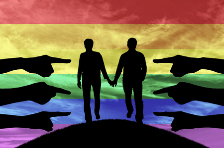accused: Discrimination against gay rights. Silhouette hands show condemning gay couple