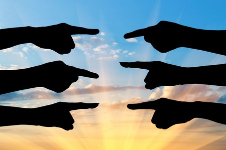 conflictos sociales: Concept of the conflict parties. Silhouette of hands of people point the finger at each other