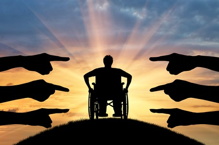 humiliation: Discrimination against the disabled. Silhouette of hands, denouncing show on the disabled in the chair wheelchair Stock Photo