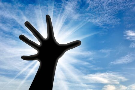 the believer: Prayer and the concept of religion. Hand believer reaches for the sky