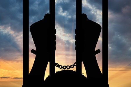 freedom concept: Freedom concept. Silhouette of human hands in handcuffs against the sky
