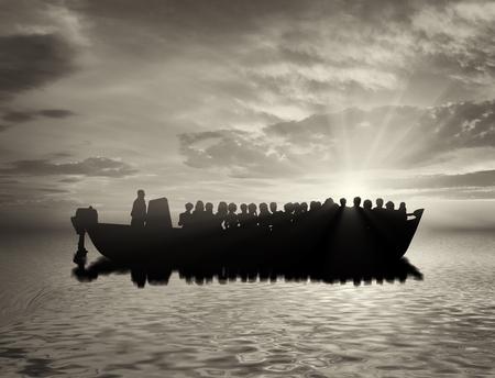 難民概念。海でボート難民と 写真素材
