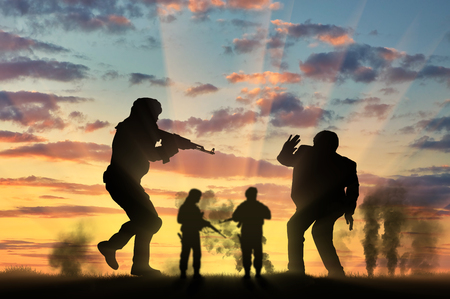 hostages: Terrorism concept. Terrorist attack on a peaceful man on background smoke Stock Photo