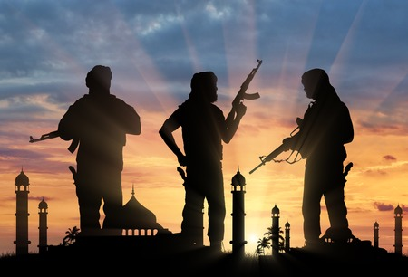 terrorists: Terrorism and conflict. Armed terrorists on the background of the mosque Stock Photo