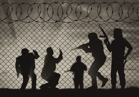 hostages: Terrorism concept. Terrorist attack on civilians near the fence of barbed wire