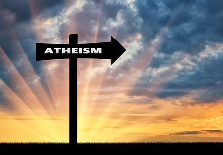 Atheism concept. Road sign of atheism at sunset Stock Photo