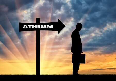 atheist: Atheism concept. Man is an atheist in the direction where the sign shows atheism