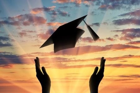 throw up: Hands graduate cap throw up into sky sunset. Study concept Stock Photo
