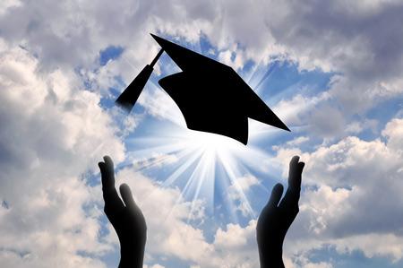Hands graduate cap throw up in sky. concept of education Standard-Bild