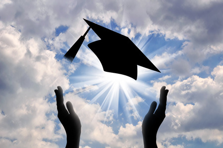 Hands graduate cap throw up in sky. concept of education Imagens