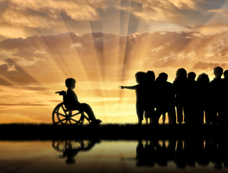chased: Disabled child in wheelchair and children chased him near sea reflection sunset. Concept disabled child Stock Photo