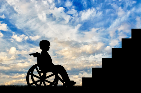 child sitting: Disabled child sitting in wheelchair front of stairs day. Disabled children concept Stock Photo