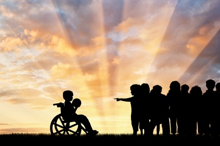 misunderstanding: Disabled child in a wheelchair with a ball and the children do not want to play with him. Children with disabilities concept