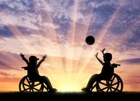 Happy children disabilities play ball sunset. Concept happy children disabilities