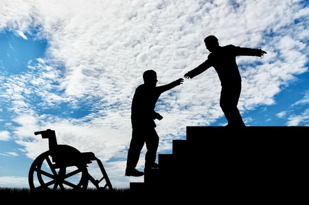 desires: Man gives helping hand to disabled person in wheelchair day. Concept assistance disabled persons