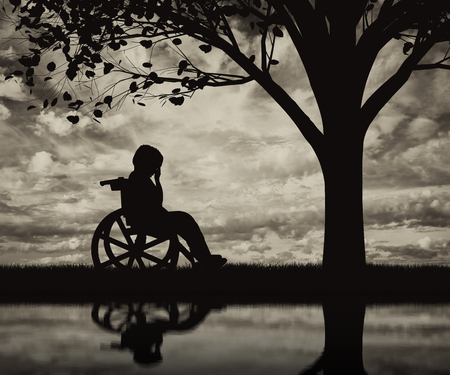 helplessness: Disabled child in a wheelchair crying near tree on beach and reflection. Concept disabled child Stock Photo