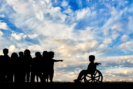 banish: Disabled child in wheelchair and children banish him day. Concept disabled child