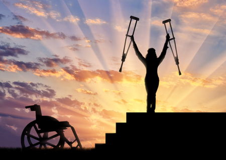 Happy disabled person standing on stairs and holding crutches wheelchair. Concept happy disabled