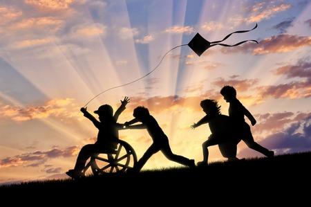車椅子の子供たちと凧で遊んで幸せな少年日没。無効になっている概念幸せな子 写真素材