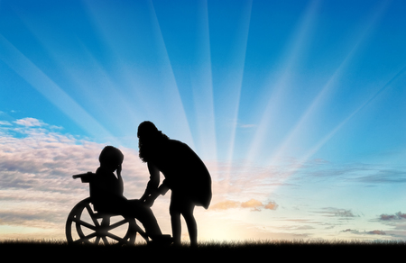 helplessness: Disabled child in wheelchair crying and his mother day. Concept of disability