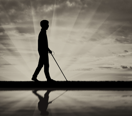 Blind man with cane disabled near water and reflection on black background white. Concept help blind disabilities