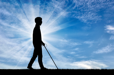 Blind man with cane disabled person goes on street day. Concept help blind people disabilities Stock Photo