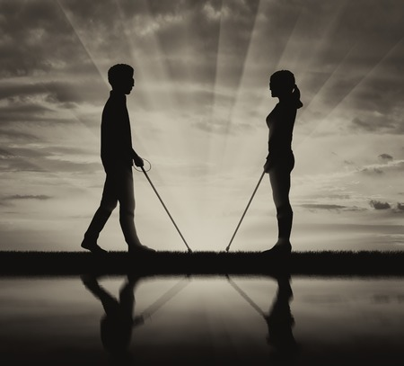Blind men and women with disabilities with a cane and reflection in water black white. Concept help blind people disabilities