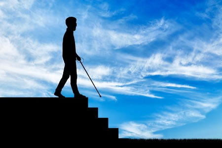 Blind man disabled with cane stay on top step day. Concept help blind disabilities