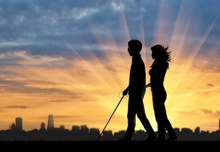 unprotected: Blind man with cane disabled and nurse are on background of city and sunset. Concept help blind disabilities