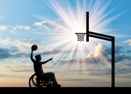 Paralympic disabled person in wheelchair rolls ball into basket day. Concept sport and willpower