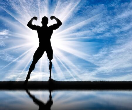 prosthetic: Paralympic disabled bodybuilder with prosthetic leg standing in pose and reflection day. Concept handicapped and sport Stock Photo