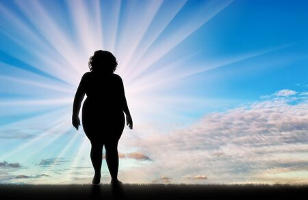indecisive: Fat woman standing on background sky. Concept obesity