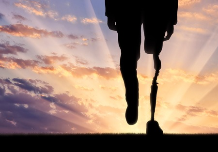 amputation: Leg with prosthesis on background sunset. Concept disabled person