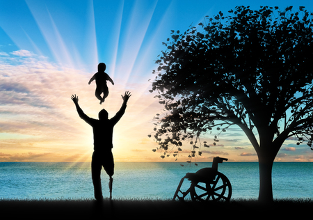 Disabled person with prosthetic leg with small child playing and tree. Concept disabled and family
