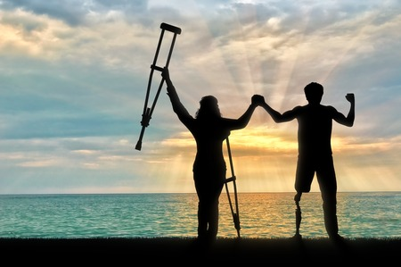 Disabled person with prosthesis and crutches near sea holding hands. Concept disabled
