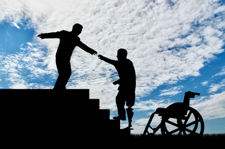 Disabled in wheelchair holding hand of man and climb stairs day. Concept help disabled Stock Photo