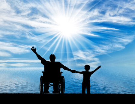 Happy disabled person in wheelchair hold son for hand and they happy near sea day. Concept happy disabled and family