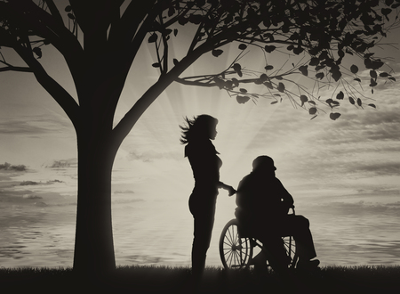 capable: Disabled persons in wheelchair and nurse under tree near sea black and white. Concept of disability Stock Photo